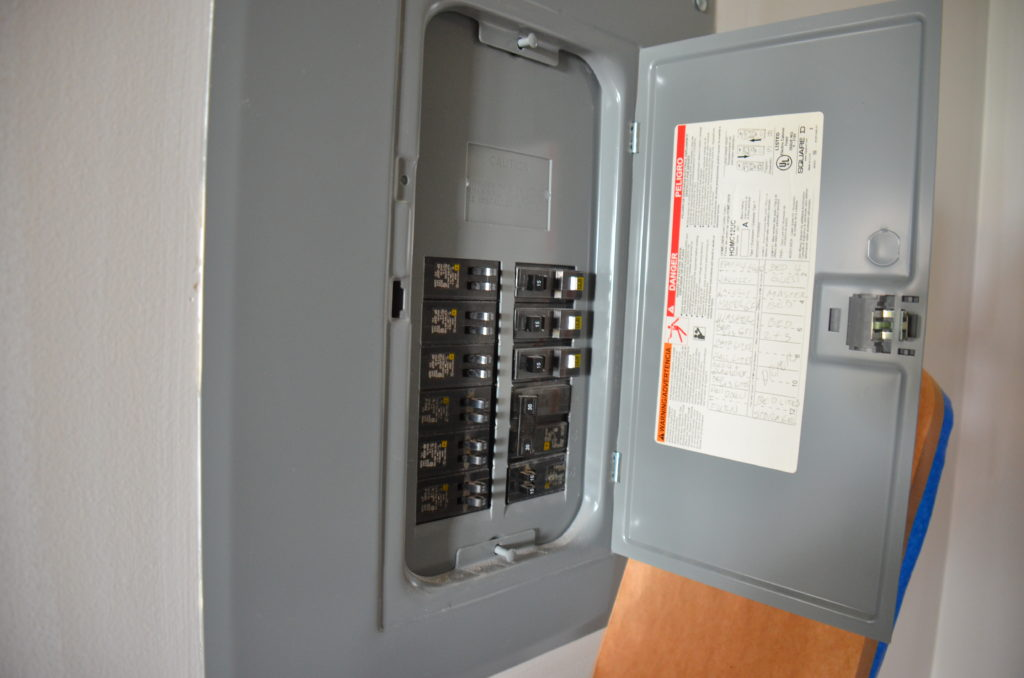 Image of an open electrical distribution panel with circuit breakers