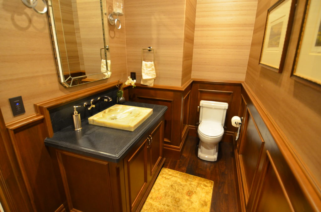 image showing wood cabinet and trim powder room