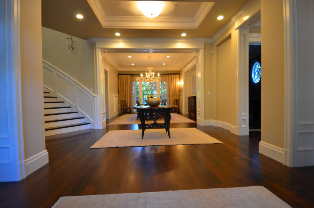 Image of formal entry with dark wood floors