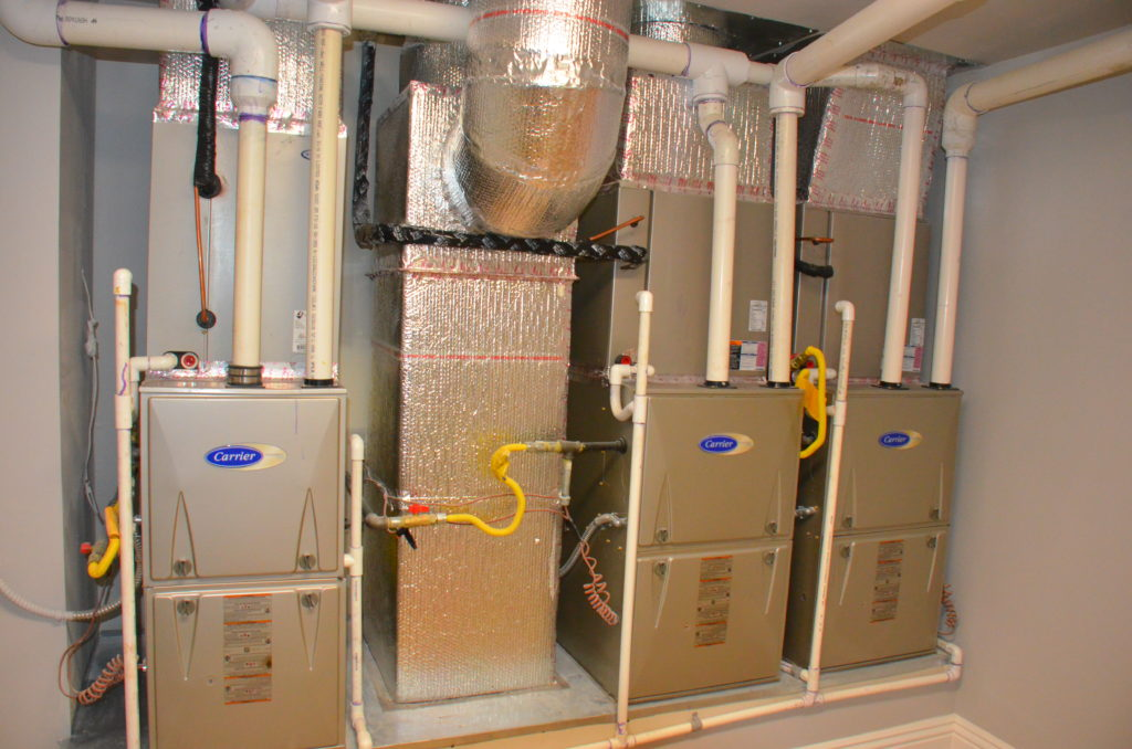 Image of three side by side high efficiency furnaces