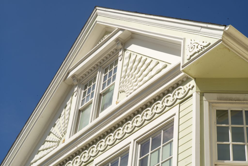 Image of Victorian gable with ornate window and surrounding trim