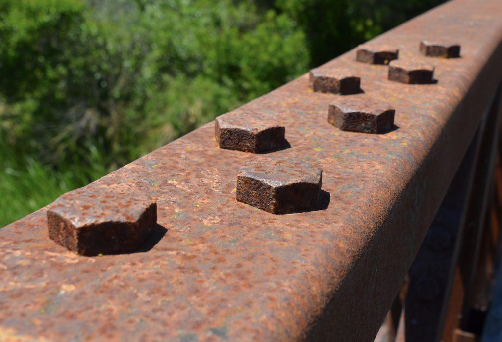Image of rusting corten steel bridge with fasteners