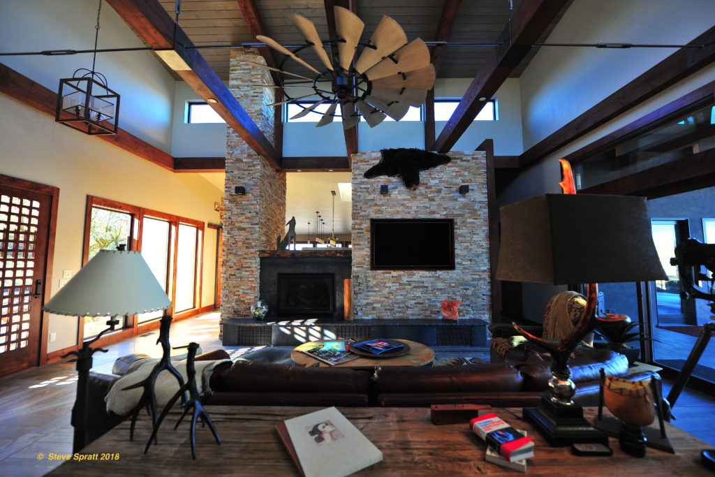Image of high beams living room, fireplace and ceiling fan certainly will need a user guide for your home