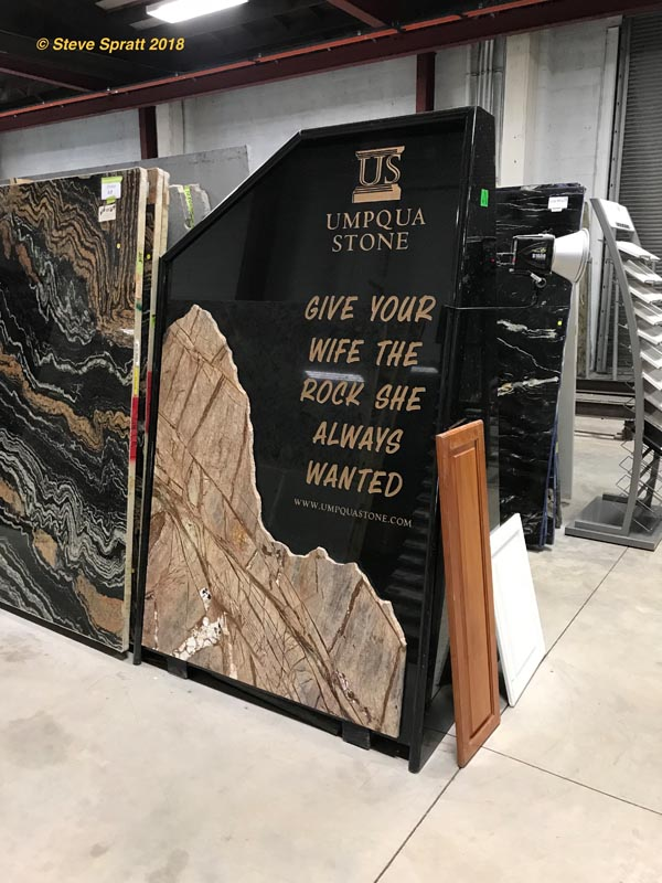 "Image of stone counter advertisement saying ""give your wife the rock she always wanted"""