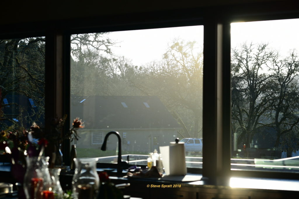 Image comparing clear insulated windows with a failed, foggy unit.