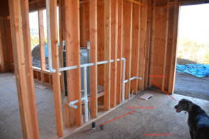 Central vac pipes in wall framing