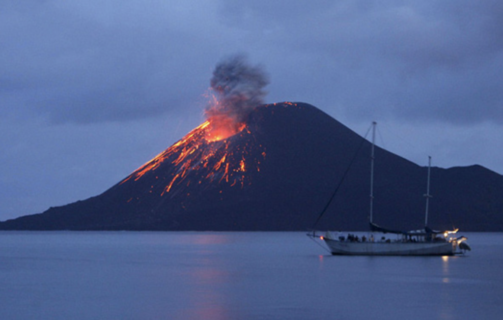 Image of a volcano erupting and creating the need for a family emergency strategy