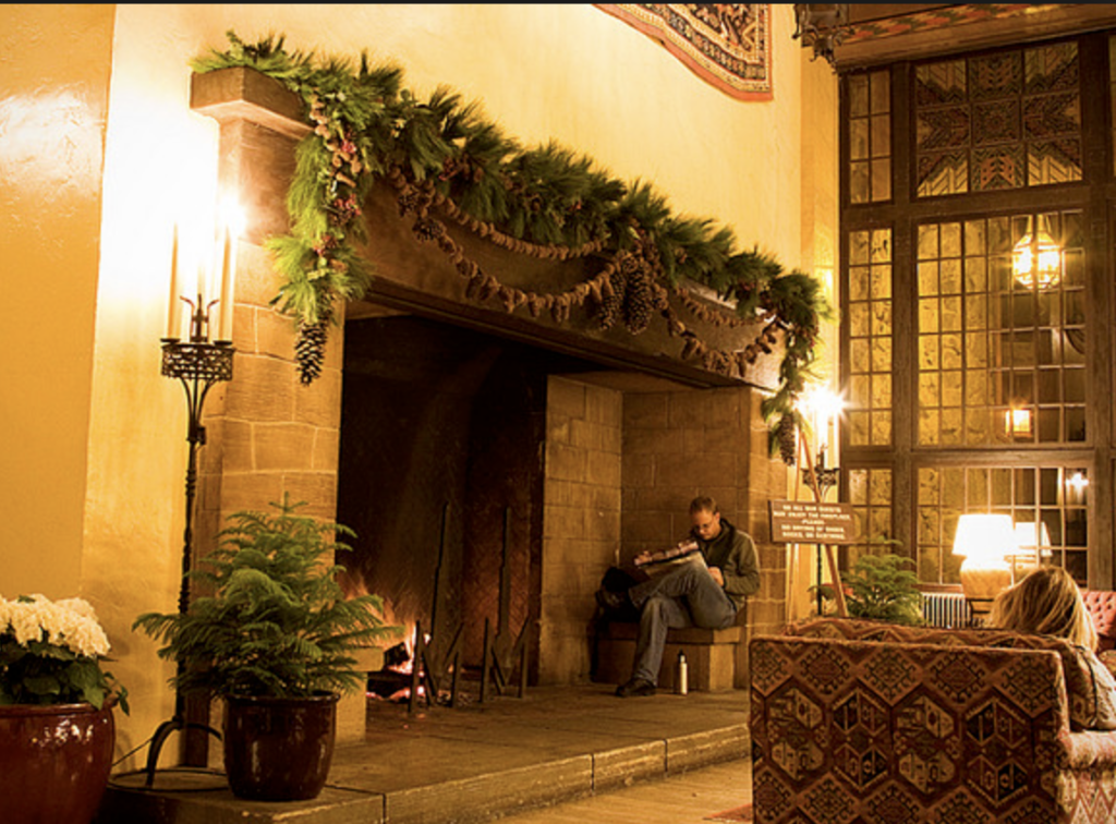 Image of oversized walk-in fireplace with garland decorations for Xmas early climate control system
