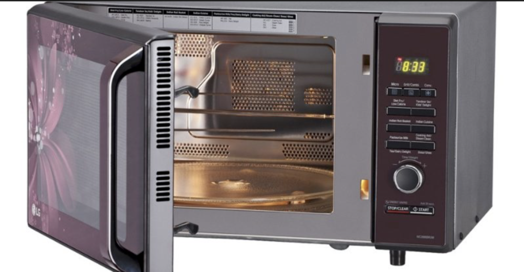 image of a new microwave oven with door slightly open to interior view