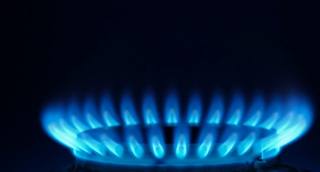 Image of natural gas cooktop burner blue flames