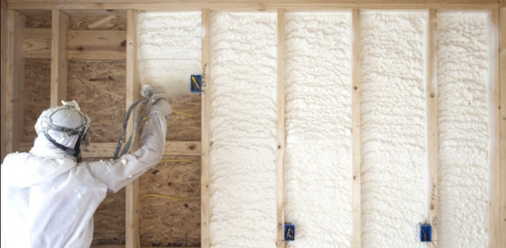 Image of spray foam insulation being installed in framing