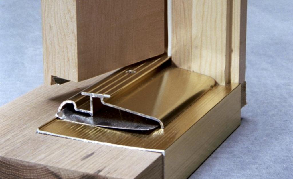 cutaway Image of brass door threshold