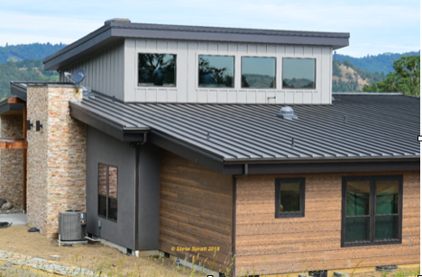 Image of contemporary home with metal roof and wood siding