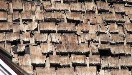 Image of worn out wood roofing.