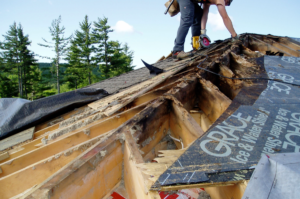 image showing rotted section of roof framing under removed roof surface