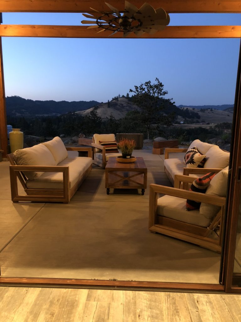 image of outdoor patio see through window wall application
